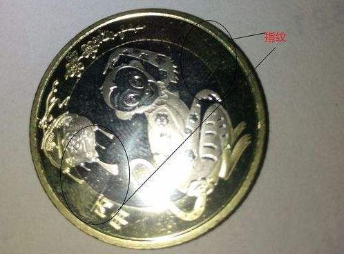教你怎样去除纪念币表面的指纹印?