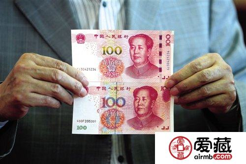 发行新版百元钞票衬托人民币国际化